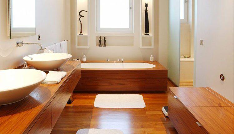 Phòng tắm được thiết kế nổi bật với gam màu trầm ấm của gỗ tự nhiên