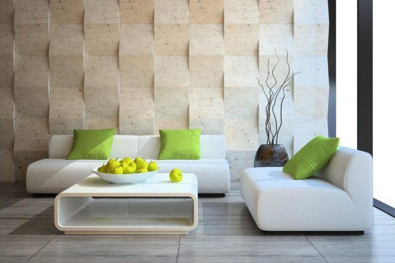 Bộ ghế sofa gam màu trắng cùng với những chiếc gối xanh tạo điểm nhấn hoàn hảo cho tổng thể không gian