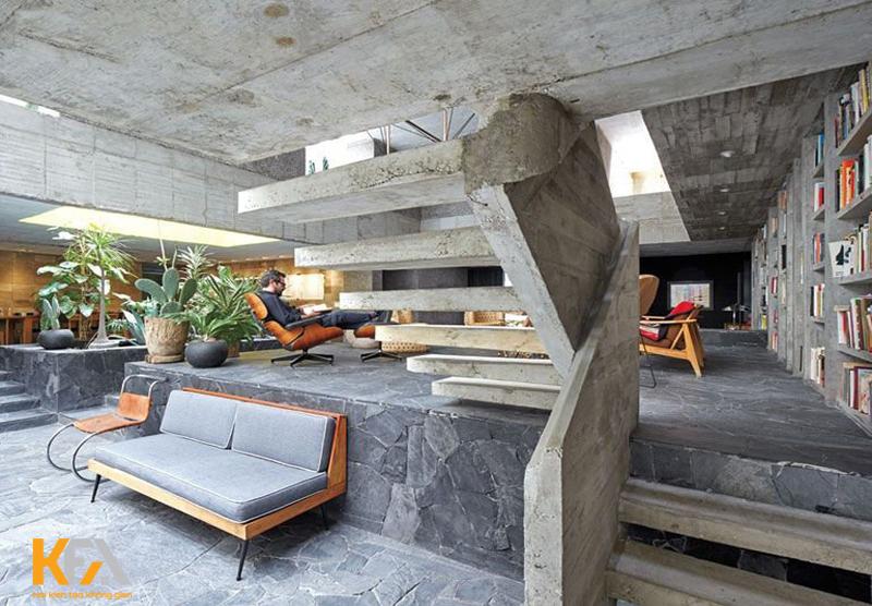 Bàn ghế bằng gỗ hay lò sưởi đá trong phòng khách có thể sử dụng để tăng thêm vẻ đẹp độc đáo